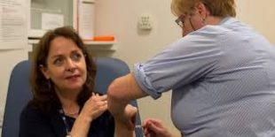 Helen Donovan having her flu jab